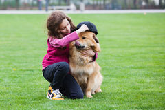 Cute girl with her dog Royalty Free Stock Photos