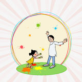 Cute girl with her father for Holi festival celebration. Stock Photos