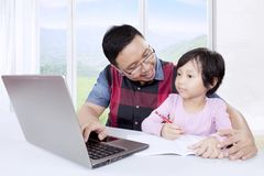 Cute girl with her father learn to write Royalty Free Stock Photos