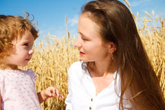 Cute girl and her mother Royalty Free Stock Photo