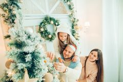 Happy girl decorating Christmas tree.Family, christmas, ,happiness concept Stock Images
