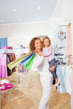 Cute girl with her mother holding shopping bags Stock Image