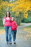 Cute girl with her mother walking in park Stock Image