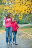 Cute girl with her mother walking in park Royalty Free Stock Photo