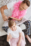 Cute girl and her parent doing girly things Stock Image
