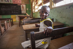 Cute girl at her school in Africa. Akosombo, Ghana - January 8, 2014: Young Sofia sitting by her desk in primary school in Akosombo, Ghana, West Africa Stock Photography