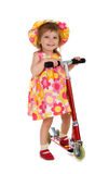 Cute girl and her scooter Stock Image