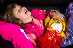 Cute girl with her toy on the sofa stock image