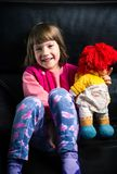 Cute girl with her toy on the sofa royalty free stock photo