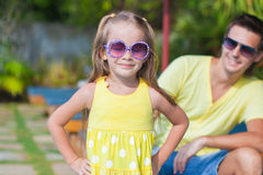 Cute girl with her young dad near swimming pool Royalty Free Stock Photo