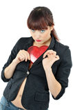 Cute girl hiding plastic heart Stock Photos