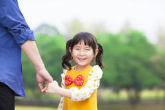 Cute girl hold father hand Royalty Free Stock Photo