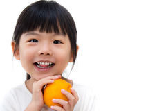 Cute girl hold orange Royalty Free Stock Image