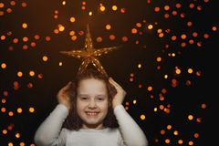 Cute girl hold star on her head and have fun. Stock Image