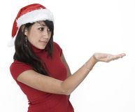 Cute Girl Holding ... Cute Girl in Santa Hat Holding royalty free stock photos