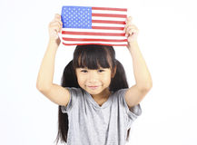 Cute girl holding an American Flag Stock Images