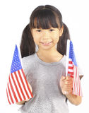 Cute girl holding an American Flag Royalty Free Stock Photo
