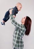 Cute girl holding baby brother. A big sister giving her baby brother some love Stock Images