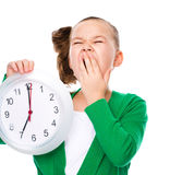 Cute girl is holding big clock Stock Images