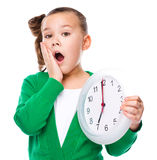 Cute girl is holding big clock Royalty Free Stock Photography