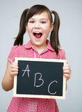 Cute girl is holding blackboard Stock Photos