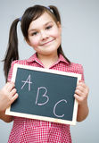 Cute girl is holding blackboard Stock Photography