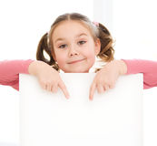 Cute girl is holding blank banner Royalty Free Stock Images