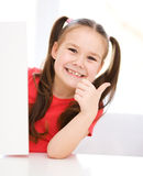 Cute girl is holding blank banner Royalty Free Stock Photos