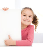 Cute girl is holding blank banner Royalty Free Stock Photo