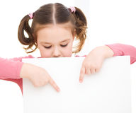 Cute girl is holding blank banner Stock Photo