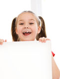 Cute girl is holding blank banner Stock Photos