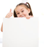 Cute girl is holding blank banner Stock Image