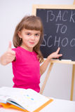 Cute girl is holding book. School concept Stock Photo