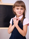 Cute girl is holding book. School concept Royalty Free Stock Photos