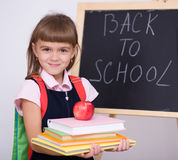 Cute girl is holding book. School concept Royalty Free Stock Image