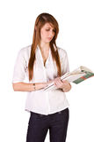 Cute Girl Holding Books and Magazine Royalty Free Stock Photo
