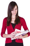 Cute Girl Holding Books and Magazine Stock Photography