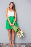 Cute girl holding bouquet with flower Royalty Free Stock Photography