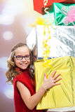 Cute girl holding bunch of presents. Royalty Free Stock Photo