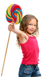 Cute girl holding candy stic. Royalty Free Stock Image