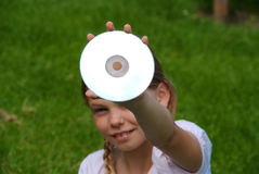 Cute girl holding CD Royalty Free Stock Images