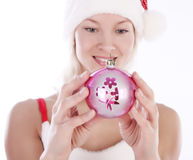 Cute girl holding Christmas toy Stock Photo
