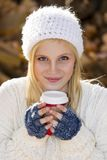 Cute girl holding coffee Stock Photo
