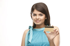 Cute girl holding credit card Royalty Free Stock Photos