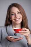 Cute girl holding a cup of coffee Stock Image