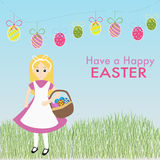 Cute girl holding the easter eggs basket. On the grass background Stock Photography