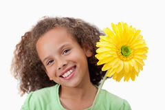 Cute girl holding a flower. Against a white background Royalty Free Stock Images