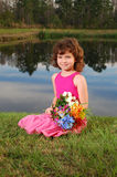 Cute girl holding flower bouqet royalty free stock photography
