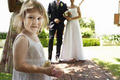 Cute Girl Holding Flower At Wedding Royalty Free Stock Image