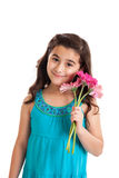 Cute girl holding flowers Stock Images